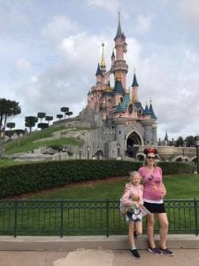 France holiday - Kate and Abigail in front of Sleeping Beauty's castle - Disneyland Paris
