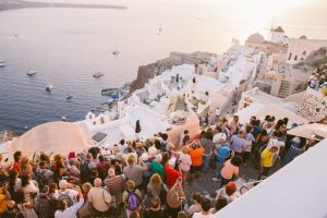 Crowds at a Santorini sunset on a cruise holiday - Strawberry Holidays Blog