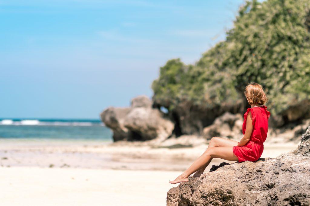 Woman on Beach - Photo by Artem Beliaikin on Unsplash